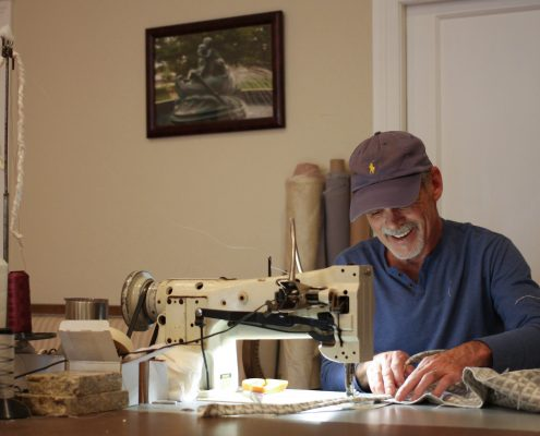 Tommy Sherrell, custom upholsterer working at his studio in Downtown Laurel, MS.
